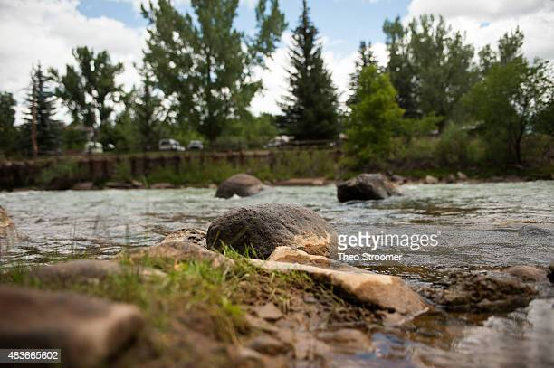 Residue from the release of nearly 3 million gallons of mine wastewater sits on rocks in the Animas River on August 11 2015 in Durango Colorado The...
