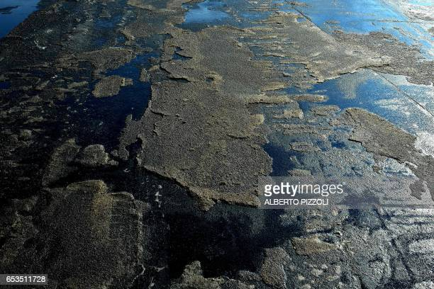 A residue of sugar is left on the quayside of French sugar cooperative Cristal Union's commercial dock after sugar was unloaded at the SFIR...