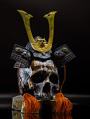 Kabuki Mask, Resin Made Skull Bushido Legend Warrior with Iron Hat closeup on background.