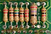 Resistor soldered on an old circuit board (macro)