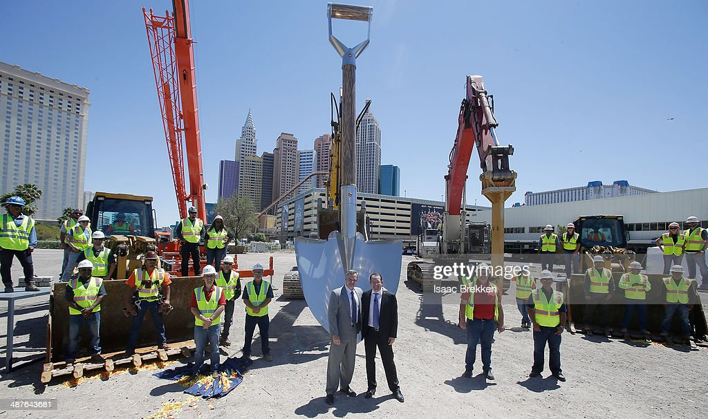 Resorts International Chairman and CEO Jim Murren (L) and President and CEO of AEG Dan Beckerman pose with construction workers during a groundbreaking for a USD 375 million, 20,000-seat sports and entertainment arena being built by MGM Resorts International and AEG on May 1, 2014 in Las Vegas, Nevada. The arena is scheduled to open in early 2016.