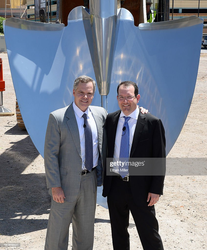 Resorts International Chairman and CEO Jim Murren (L) and President and CEO of AEG Dan Beckerman pose in front of a ceremonial shovel during a groundbreaking for a USD 375 million, 20,000-seat sports and entertainment arena being built by MGM Resorts International and AEG on May 1, 2014 in Las Vegas, Nevada. The arena is scheduled to open in early 2016.