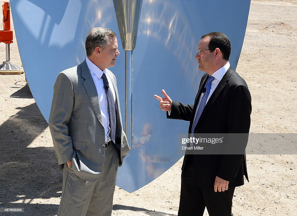 Resorts International Chairman and CEO Jim Murren (L) and President and CEO of AEG Dan Beckerman talk in front of a ceremonial shovel during a groundbreaking for a USD 375 million, 20,000-seat sports and entertainment arena being built by MGM Resorts International and AEG on May 1, 2014 in Las Vegas, Nevada. The arena is scheduled to open in early 2016.