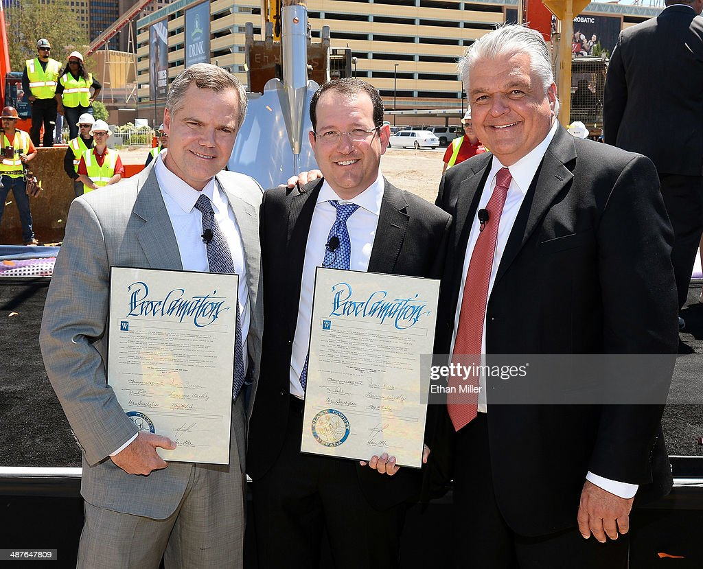 MGM Resorts International Chairman and CEO Jim Murren, President and CEO of AEG Dan Beckerman and Clark County Commissioner Steve Sisolak hold proclamations as they attend a groundbreaking for a USD 375 million, 20,000-seat sports and entertainment arena being built by MGM Resorts International and AEG on May 1, 2014 in Las Vegas, Nevada. The arena is scheduled to open in early 2016.