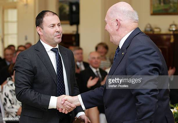 Resources Energy and Northern Australia Minister Josh Frydenberg is congratulated by GovernorGeneral Sir Peter Cosgrove during the swearingin...
