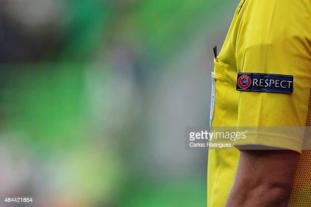 Respect logo UEFA referee during the UEFA Champions League qualifying round playoff first leg match between Sporting CP and CSKA Moscow at Estadio...