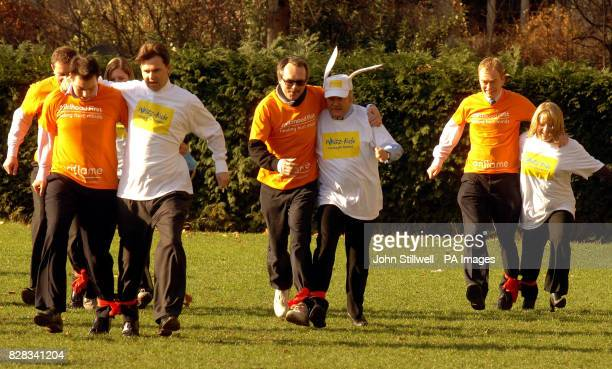 Respect MP George Galloway MP wears bunny ears while taking part in a threelegged charity race in Westminster Wednesday February 8 in support of the...