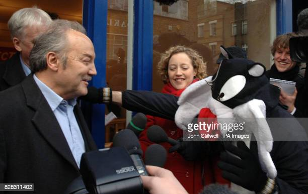 Respect Party MP and Big Brother evictee George Galloway is greeted by someone wearing a cat costume as he speaks to the media outside his...