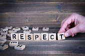 Respect. Wooden letters on the office desk, informative and communication background