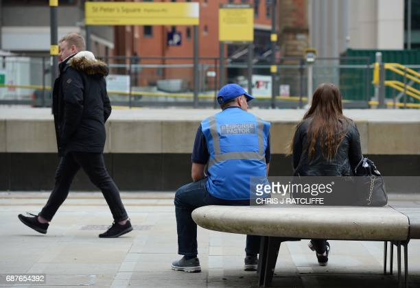 TOPSHOT A response pastor deployed into the community following a disaster or crisis woman talks with a woman near Albert Square in Manchester...