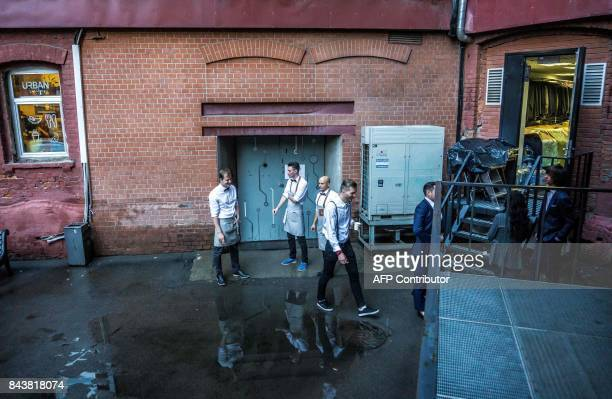 Restaurant and fashion store employees take a pause in the former Soviet time Red October Chocolate Factory in downtown Moscow on September 7 2017...
