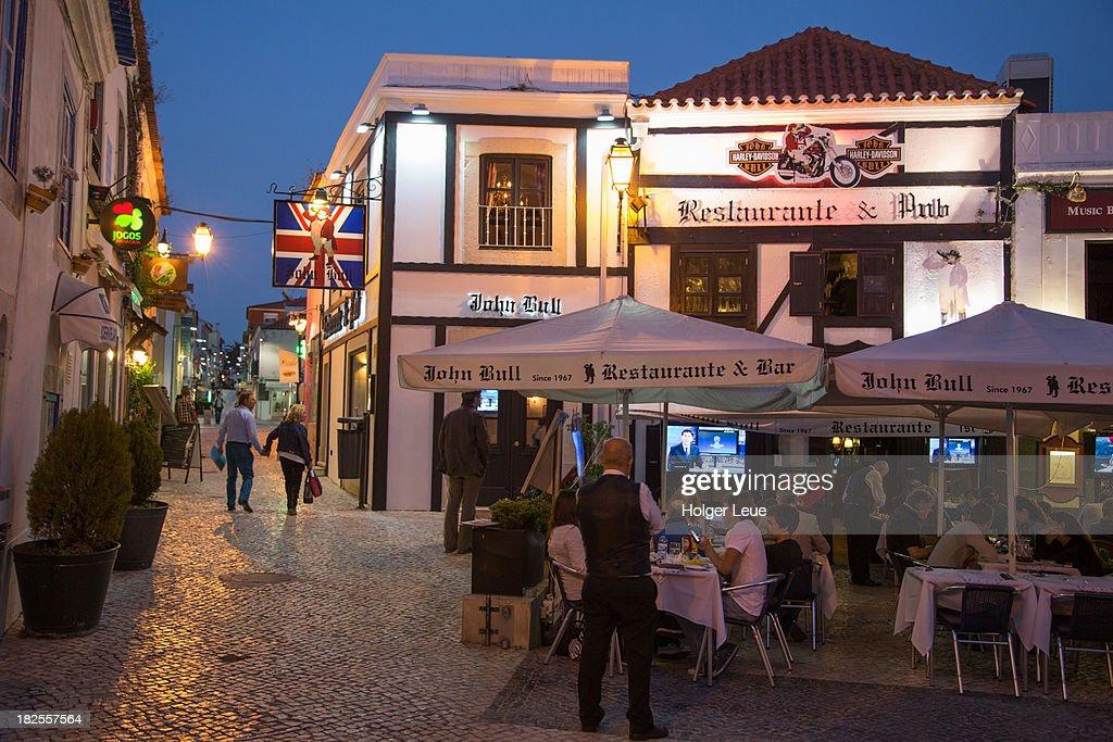 Restaurant at Praca Costa Pinto square at dusk