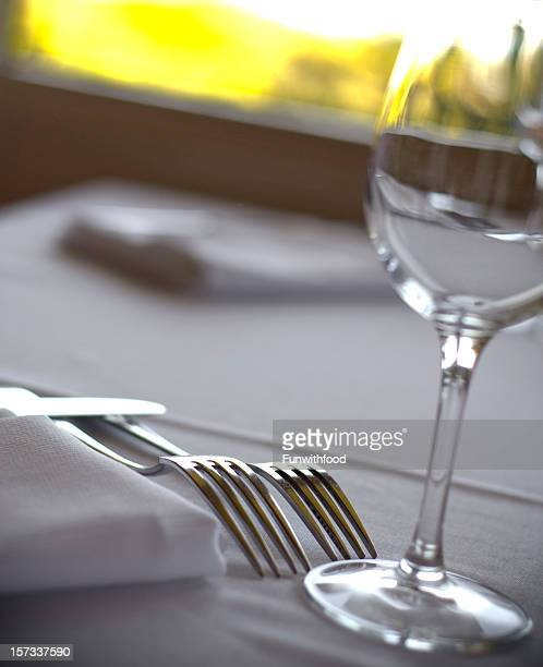 Restaurant Dining Table Place Setting & Wineglass on White Linen Tablecloth