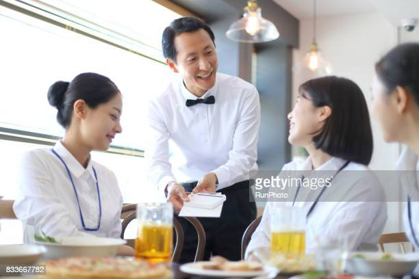 Restaurant employees and business women