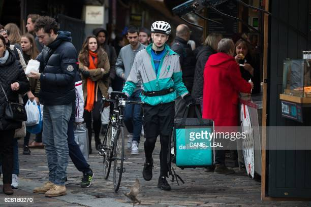 Restaurant Food Delivery company 'Deliveroo' employee Billy Shannon with a delivery while working in Camden Town north London in November 17 2016...