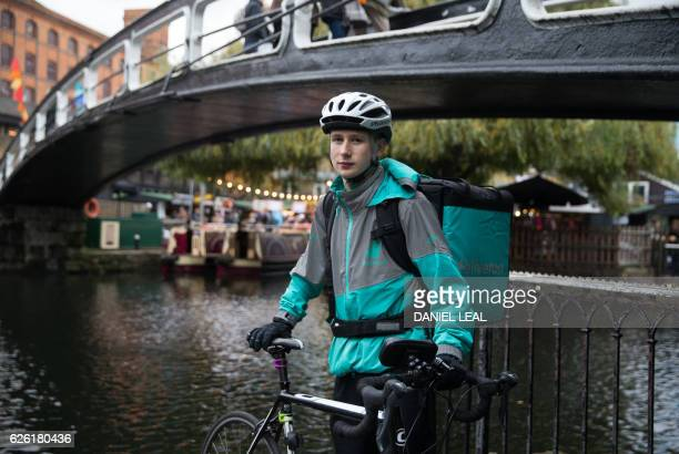 Restaurant Food Delivery company 'Deliveroo' employee Billy Shannon poses for a portrait in Camden Town north London in November 17 2016 Lunch hour...