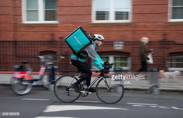 Restaurant Food Delivery company 'Deliveroo' employee Billy Shannon at work in Camden Town north London in November 17 2016 Lunch hour has just...