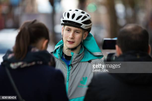 Restaurant Food Delivery company 'Deliveroo' employee Billy Shannon speaks with AFP reporters during an interview in Camden Town north London in...