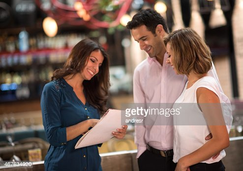 Restaurant hostess welcoming customers