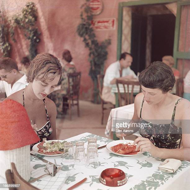 A restaurant in Positano Italy 1958 One of the woman is art director Edna Lewis