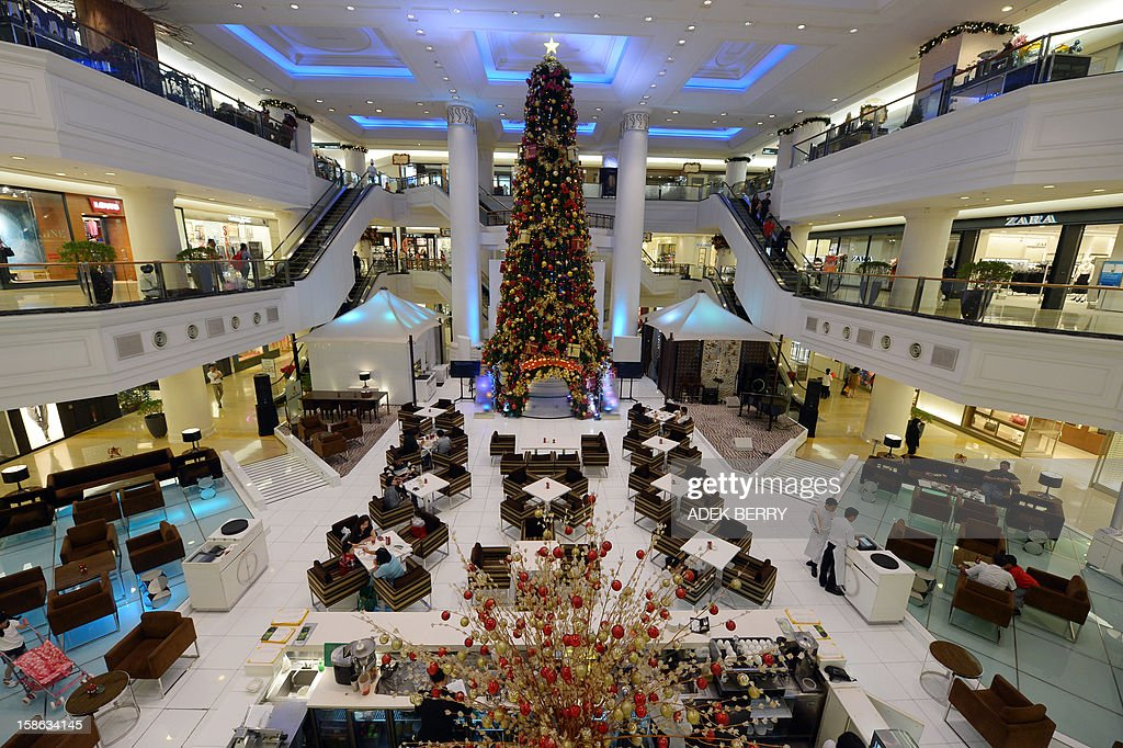 A restaurant inside a shopping mall is decorated with Christmas ornaments in Jakarta on December 22, 2012. Many shopping malls and business centres in Indonesia, the largest Muslim-majority nation in the world, are decorated with Christmas ornaments to welcome Christmas and New Years. AFP PHOTO / ADEK BERRY