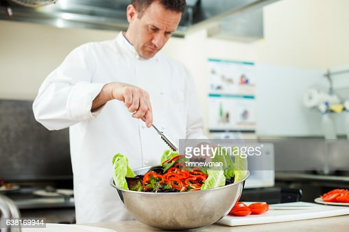 Restaurant Kitchen Chefs restaurant kitchen chef chopping vegetables stock photo | getty images