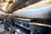 """The """"hot-line"""" and vent-hood of a diner restaurant."""