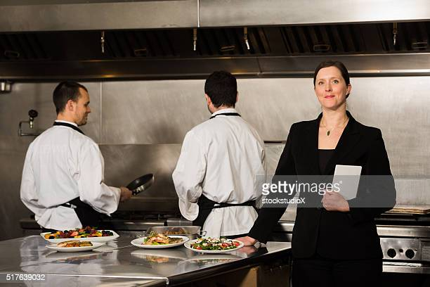 Restaurant manager in a commercial kitchen