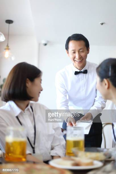 Restaurant manager who is asking for food and bill