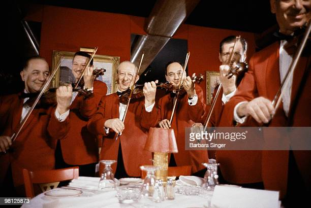Restaurant musicians playing violins