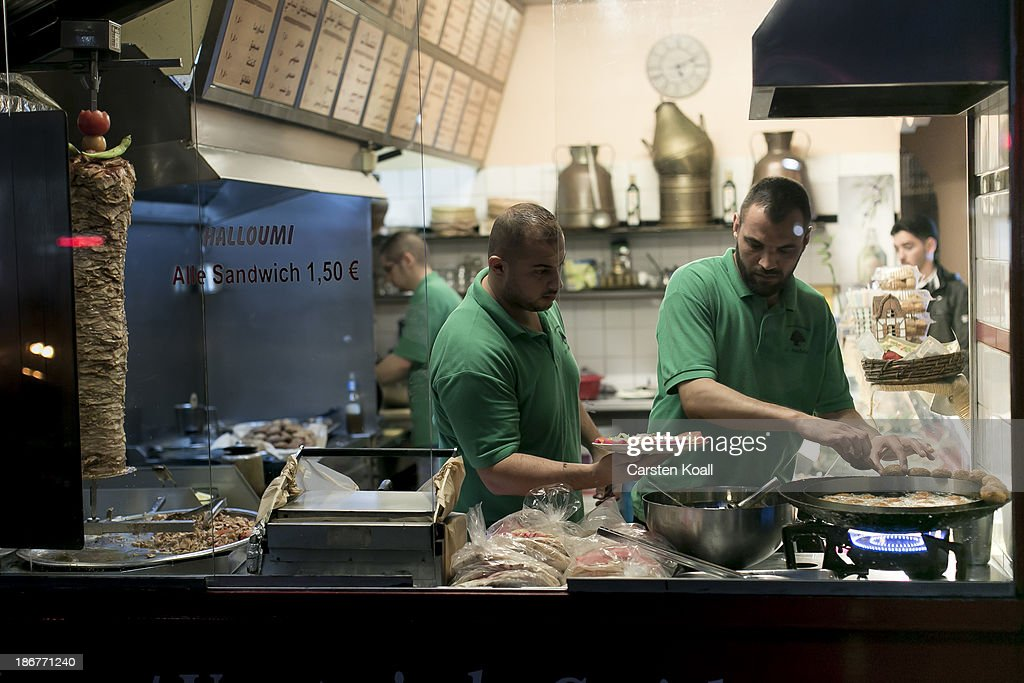 Restaurant owner Habib Hassoun (R) and his brother Hassan Hassoun (L) prepare falafel in his restaurant at Sonnenallee in Neukoelln district on October 29, 2013 in Berlin, Germany. According to recently published statistics, 7.2 million foreigners were living in Germany by the end of 2012, which is the highest number ever recorded. Of those 80% are from countries in the European Union, while the rest come primarily from Turkey, Russia, the former Soviet states and Arab countries.
