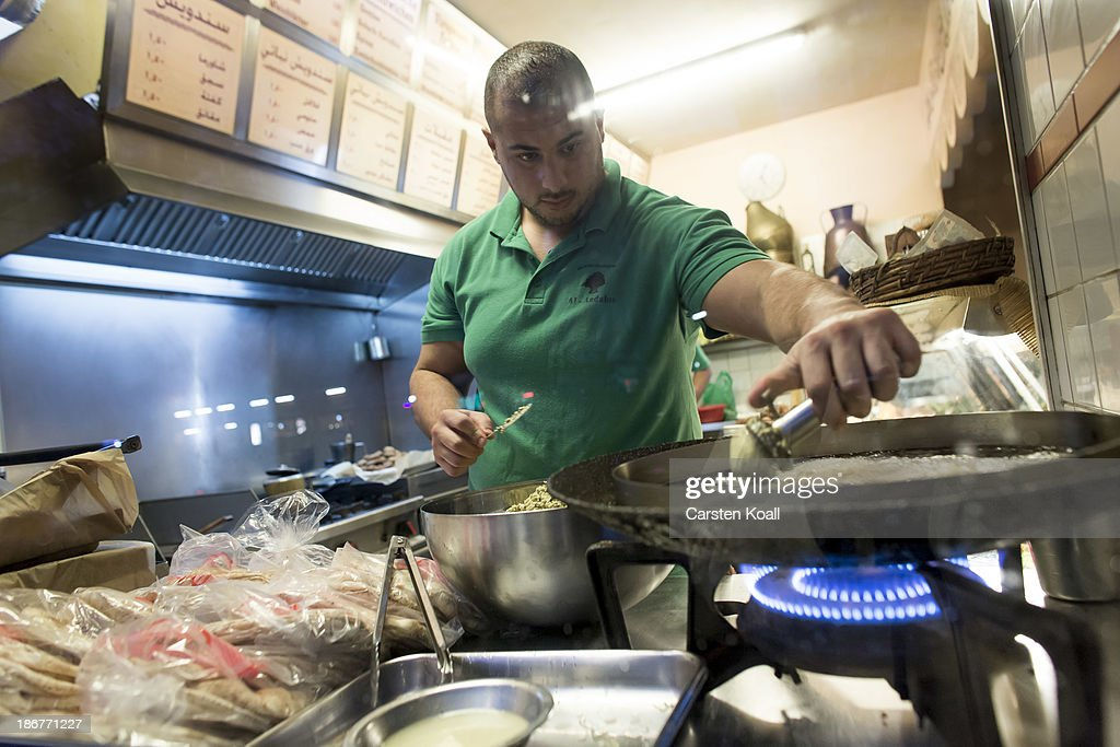Restaurant owner Habib Hassoun prepares falafel in the restaurant at Sonnenallee in Neukoelln district on October 29, 2013 in Berlin, Germany. According to recently published statistics, 7.2 million foreigners were living in Germany by the end of 2012, which is the highest number ever recorded. Of those 80% are from countries in the European Union, while the rest come primarily from Turkey, Russia, the former Soviet states and Arab countries.