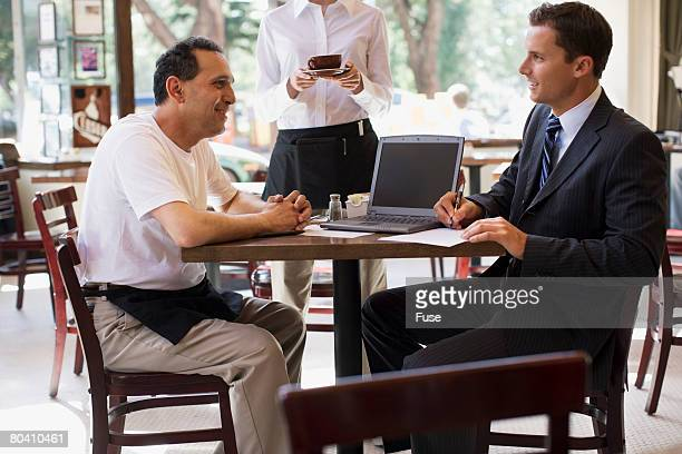 Restaurant Owner Meeting with Accountant