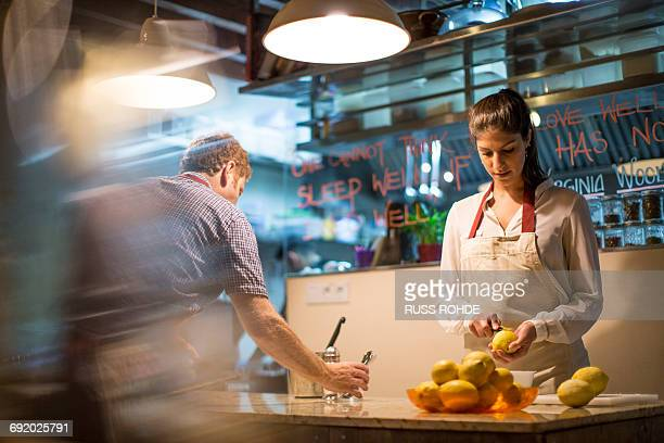 Restaurant owners working in kitchen