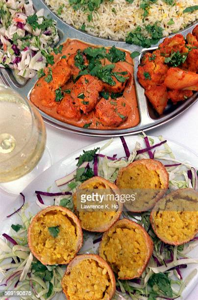 INTELLIGENCE restaurant review of Surya South Asia cuisine with dishes like Chicken Tikka Masala and Paneer Pakoras witha glass of Chardonnay