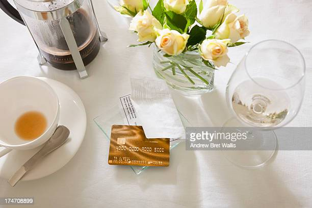 Restaurant table with bill and credit card