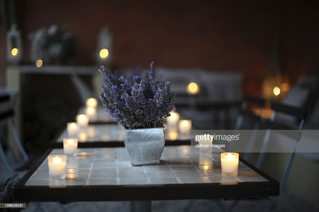 Restaurant table with lavender and candlelight : Stock Photo