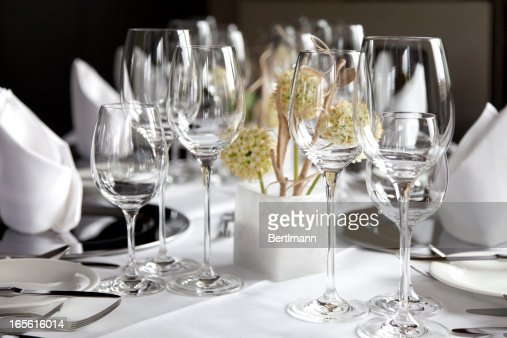 Restaurant table with wine glasses and napkins