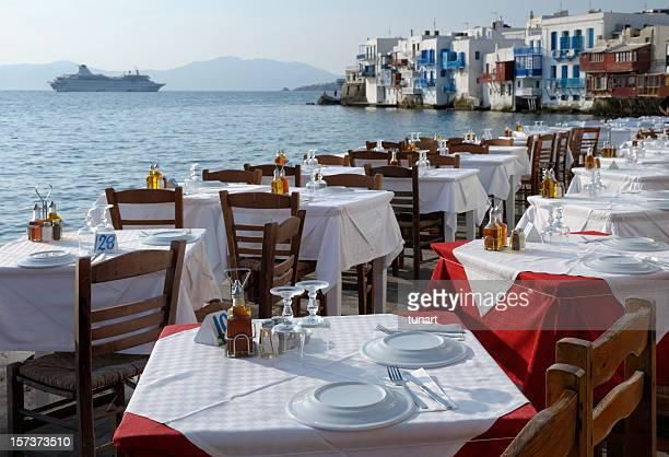 Restaurant Tables and Venetian houses in Mykonos, Greece