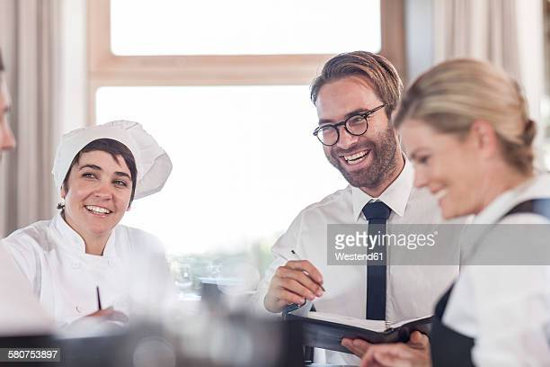 Restaurant team discussing menue and reservations