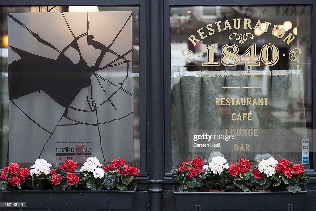 A restaurant window made to look like it has been smashed to commemorate the 75th anniversary of the Kristallnacht pogroms on November 9, 2013 in Berlin, Germany. Events are taking place across the country to commemorate the day in 1938 when Nazi followers across Germany and Austria burned down synagogues, smashed Jewish-owned businesses, looted Jewish residences and killed several hundred Jews. Anti-semitism was a central component of Adolf Hitler's rise to power and won him wide-spread sympathy among ordinary Germans and Austrians.