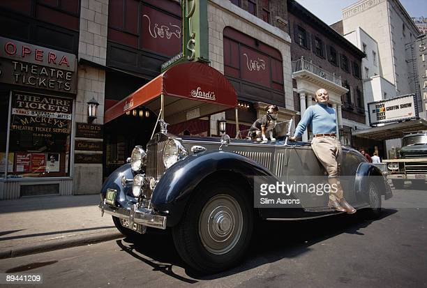 Restaurateur Vincent Sardi Jr leans on a RollsRoyce Phantom III outside Sardi's at 234 West 44th Street in Manhattan June 1969 His parents founded...
