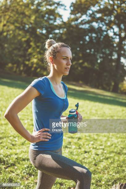 Resting after jogging with bottle of water