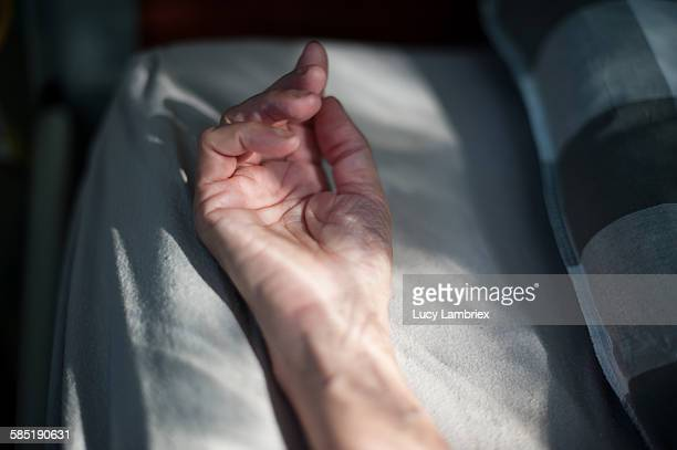 Resting hand in bed