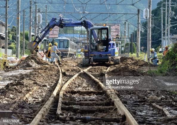 Restoration work of the JR Fukuchiyama Line begins a day after flooding at Ichijima Station on August 18 2014 in Tanba Hyogo Japan A stationary rain...