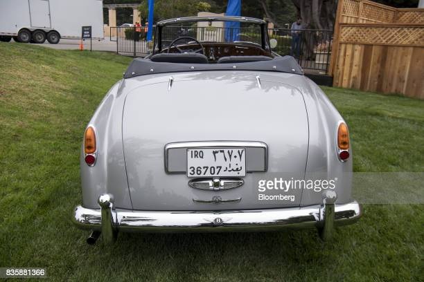 A restored 1958 Bentley S1 Continental Park Ward Drophead Coup that was found in the garage of Saddam Hussein after he was captured sits on display...