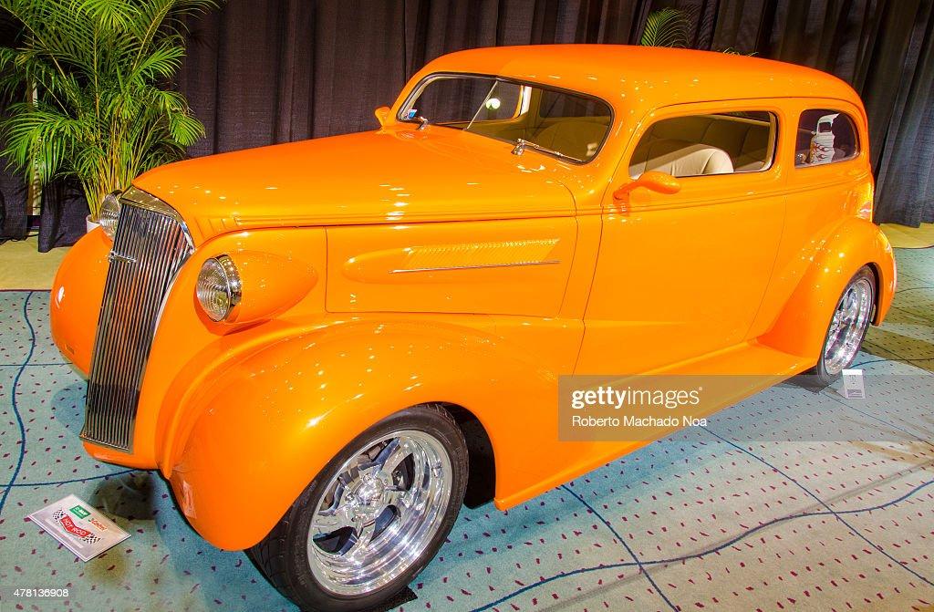 CENTRE TORONTO ONTARIO CANADA Restored car in orange color in Canada International Auto Show The Canadian International AutoShow CIAS for short is...