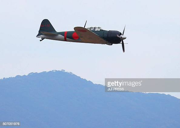 A restored World War IIera Mitsubishi A6M Zero fighter flies over Japan's Maritime Defence Force's Kanoya air base in Kanoya in Kagoshima prefecture...