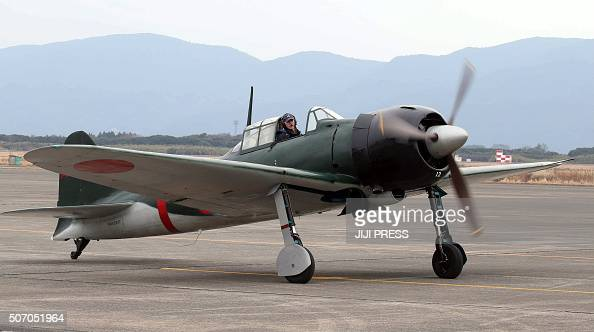 A restored World War IIera Mitsubishi A6M Zero fighter taxis on the tarmac at Japan's Maritime Defence Force's Kanoya air base in Kanoya in Kagoshima...