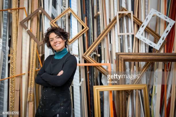 Restorer and framer laboratory craftswomen: owner portrait